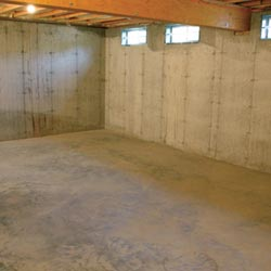 A cleaned out basement in Greenwich, shown before remodeling has begun