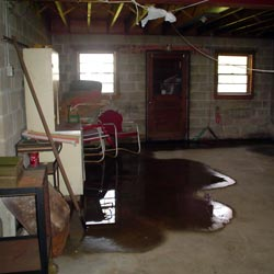 A flooded basement showing groundwater intrusion in Stamford