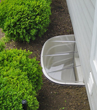 basement egress window well in Darien