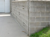 A retaining wall separating from the adjoining walls in Monroe