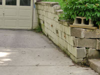 a failing retaining wall around a driveway in Stamford