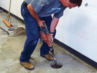 Coring the concrete of a concrete slab floor in Simsbury