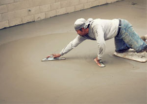 smoothing out the grout in a slab releveling project in Milford