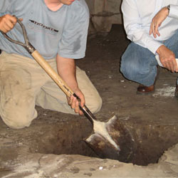 Digging a hole for the engineered fill used in a crawl space support system installation in Milford