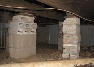 crawl space repairs done with concrete cinder blocks and wood shims in a Stratford home