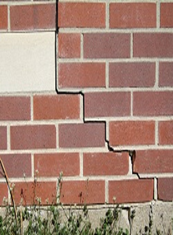photo of a rotating foundation wall with cracks in Madison