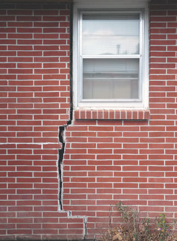 severe foundation wall cracks along a window in Somers