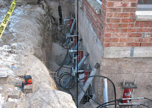 Foundation push piers installed around a house with a foundation settlement issues in Madison