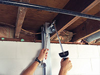 Straightening a foundation wall with the PowerBrace™ i-beam system in a New Canaan home.
