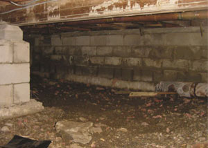 Rotting, decaying crawl space wood damaged over time in New Milford