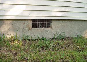 Open crawl space vents that let rodents, termites, and other pests in a home in Glastonbury