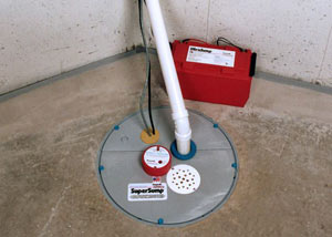 A sump pump system with a battery backup system installed in Guilford