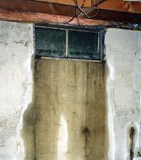 Flooding through basement windows in a Avon home.
