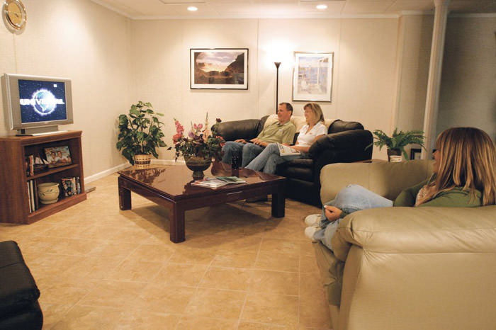 A basement finished into a comfortable family room. ... & Basement Floor Tiles in Norwalk Stamford West Hartford ...